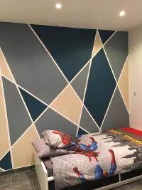 Réalisation d'un décor mural dans une chambre d'enfant sur la commune d'Estreux signé ARCO'Home